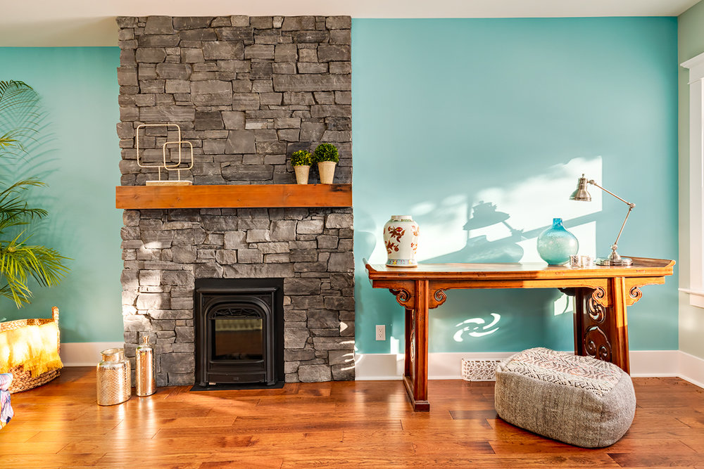 Calgary-renovation-interior-design-firplace-matle-blue-hardwood-3.jpg