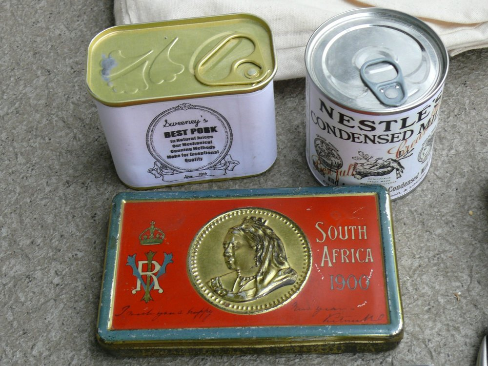 The chocolate tin is an original from the Boer War, the other tins are modern with reproduction labels.  The pull tabs are not period correct.