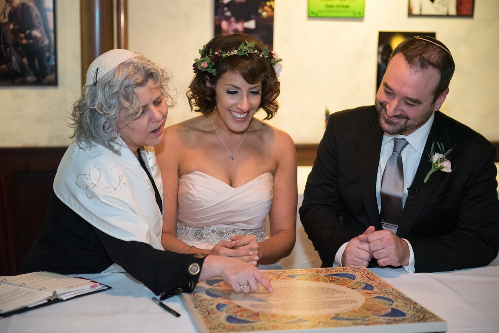 Signing the ketubah (a Jewish tradition)