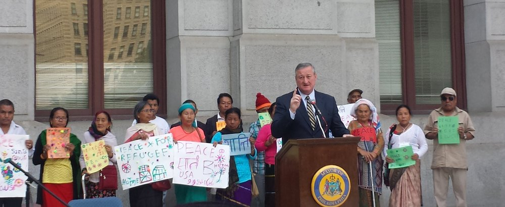 "The Mayor Jim Kenney addressing the crowd about how ""the city of brotherly love and sisterly affection"" needs to be an accepting place for refugees."