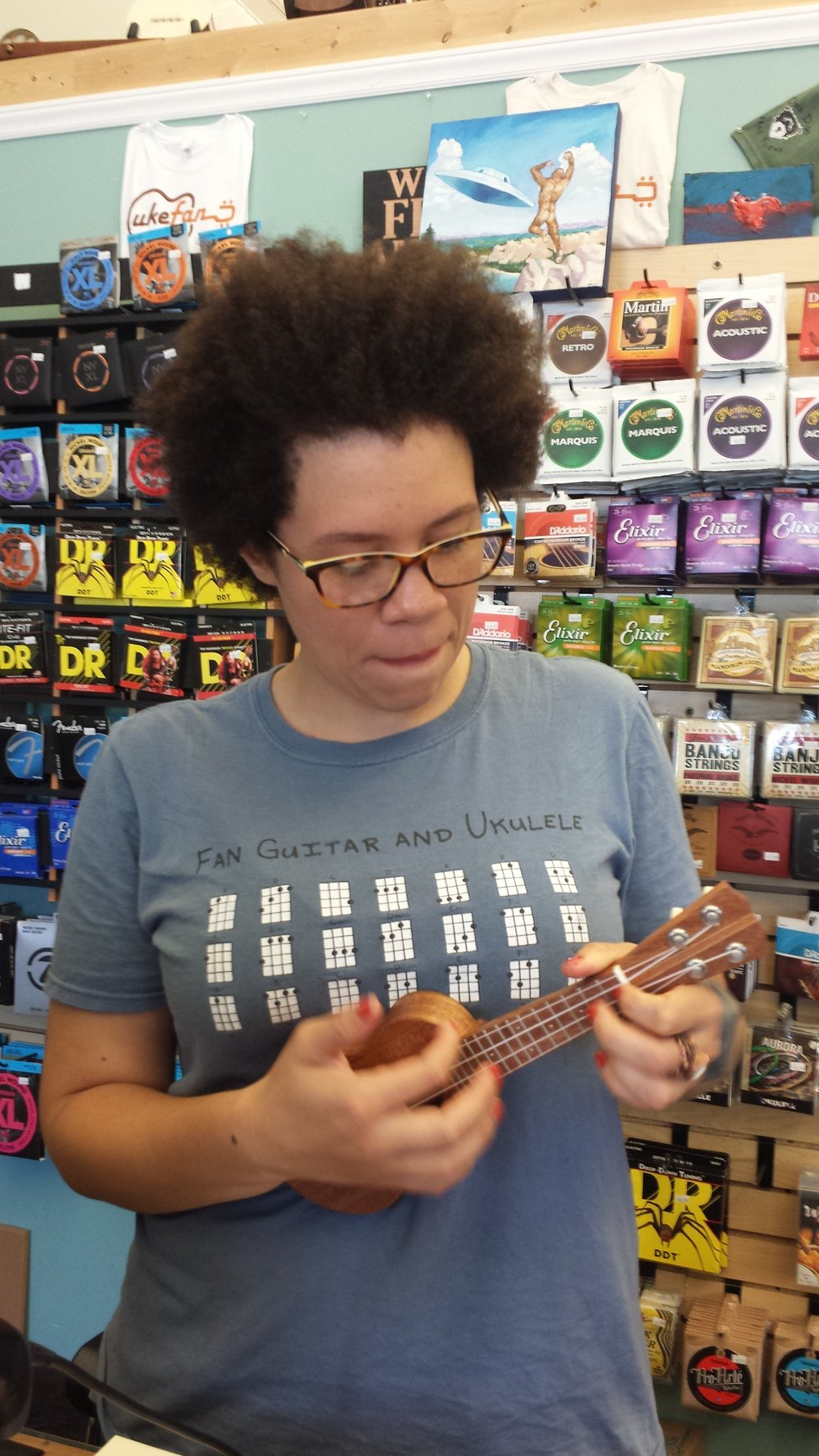 Natalie at the shop showing off her amazing skills on a pocket uke