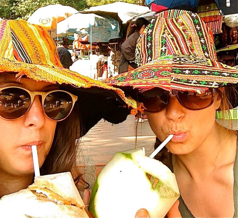 brook and julie coconut and hat thailand 2014.jpg