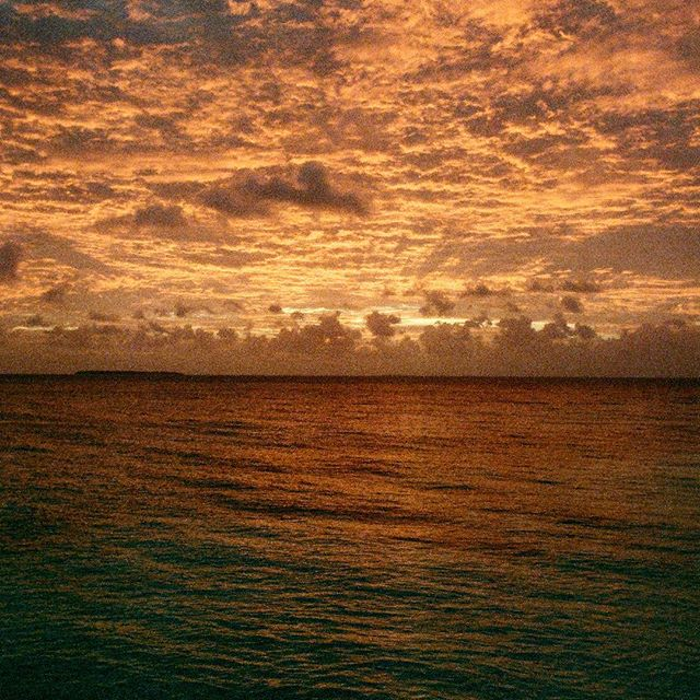 A sunset that lit up the sky and water at the Kwajalein Atoll, Pacific Ocean. . . .#pacific #pacificocean #kwajalein #atoll #pacificisland #sunset #fujifilmnatura1600 #1600iso #pentaxmesuper #analog #analog_revival #ishootfilm #filmisntdead #kristofferpfalmer #kristofferglennimagery #pfalmer