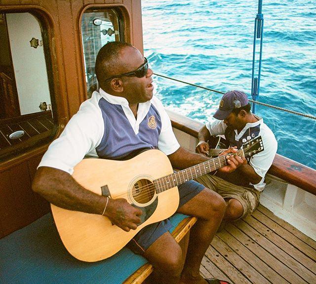 "Analog shot showing the crew of the Schooner ""Whales Tale"" in Fiji as they show us how to chill at work. Minolta X-700 shooting Kodak Ektar 100. . . .#whalestale #fiji #nadi #guitar #analogmusic #denarau #sailing #mast #sail #pacific #oceana #daycruise #traveltheworld #wanderlust #analog #filmisnotdead #ishootfilm #kodakphoto #ektar100 #minoltax700 #kristofferpfalmer #kristofferglennimagery #pfalmer"
