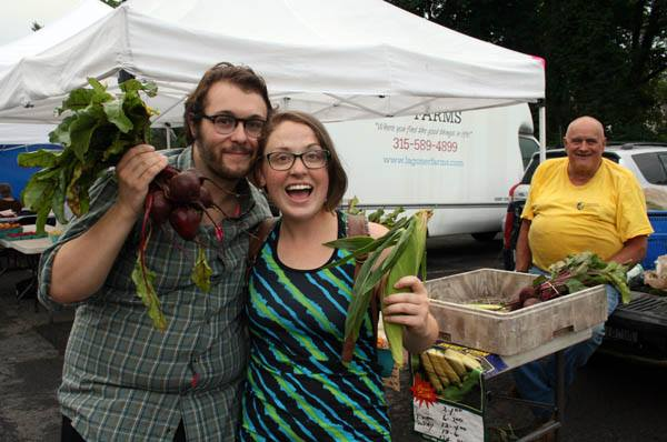 happy couple with corn and beets.jpg