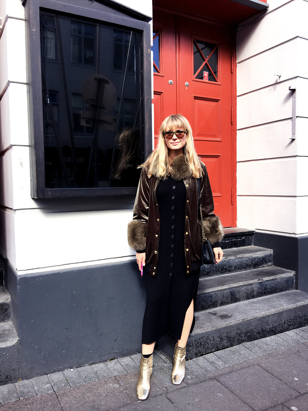 """I also love it back to black, and recently wore it for a day of meetings in Reykjavik with a vintage knit dress and golden boots by Anine Bing to make it really sing. It's extra special (and warm) with either the Khaki or Natural Crystal Fox fur cuff and collar. More is more!"""