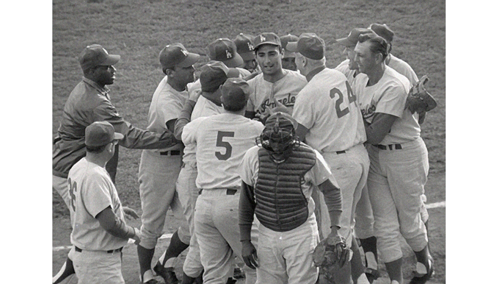 Dodgers win the World Series  Teammates surround Sandy Koufax after he hurled a 2-0 shutout over the Minnesota Twins to capture the 1965 World Series in the seventh game.