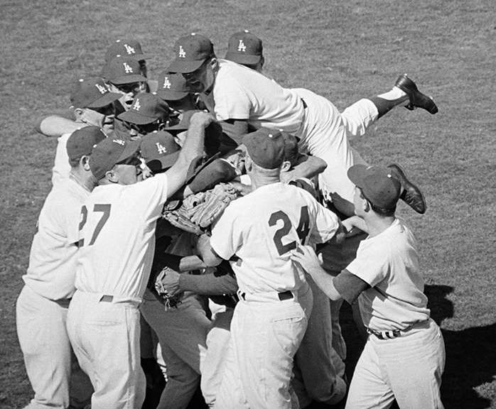 Los Angeles Dodgers win the World Series  Teammates all but bury Sandy Koufax after he pitched them to a 2-1 victory, completing the Dodgers' sweep of the Yankees for the World Series championship.