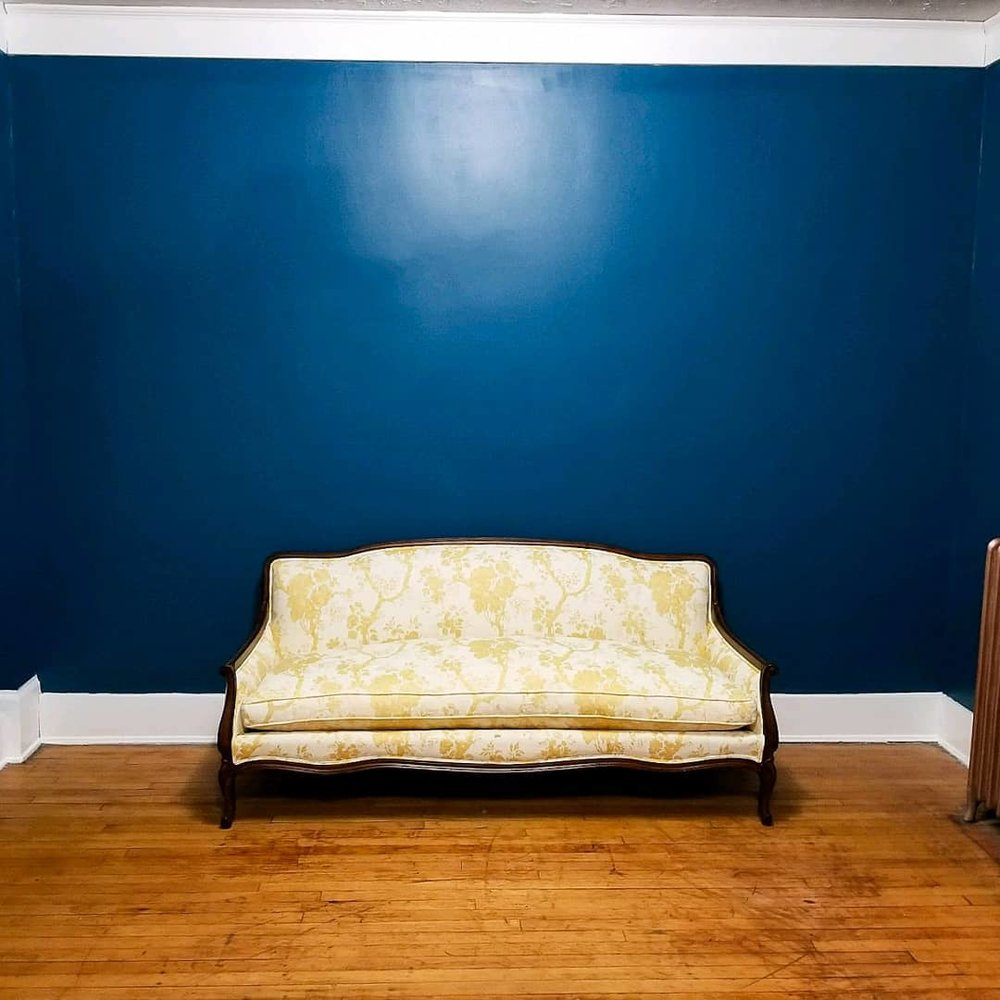 """We finally got to move in our """"new"""" sofa that Danny & Felicia brought to us (SWAT Food Truck) We just refinished it, and it looks incredible against our new gorgeous blue walls!!"""