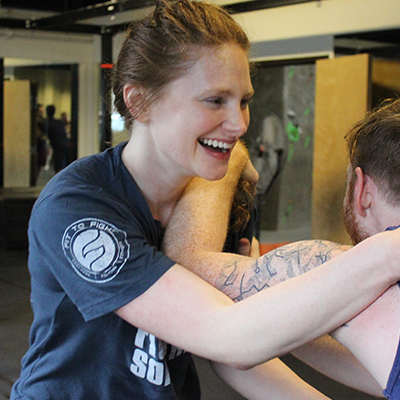 "Kathryn Angstadt is the Chief of Staff at N-Flux. Kathryn is a Fit To Fight certified instructor and a green belt. Kathryn believes in ""the offensive mindset"" —cultivating mental and physical resiliency by identifying personal limits and pushing past them in every training. She is known throughout the studio as the ""Ginga Ninja"" and is interested in tactical shooting."