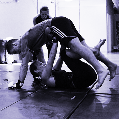 From The Ground Up™ uses the best of wrestling and Brazilian jiu-jitsu,to give you the tools realistically required to get up from the ground during an affray when your attacker seeks to hold you there.  Prerequisites: None