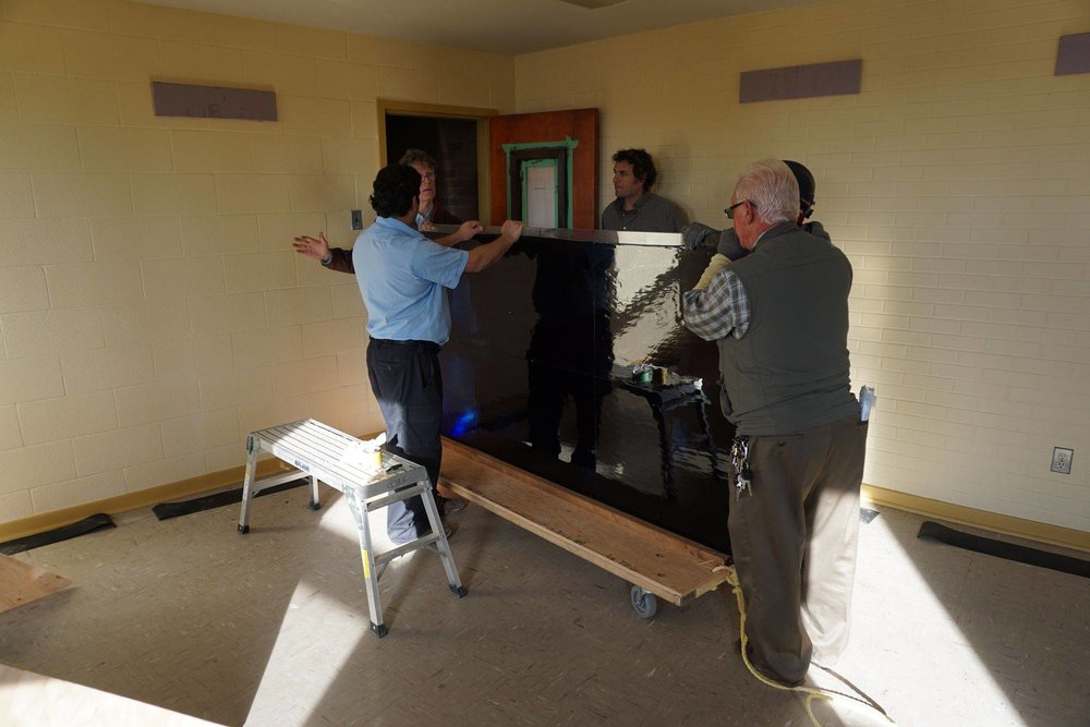 Moving and storing the artwork in the Monastery and preparing temporary viewing wood frames for display purposes.