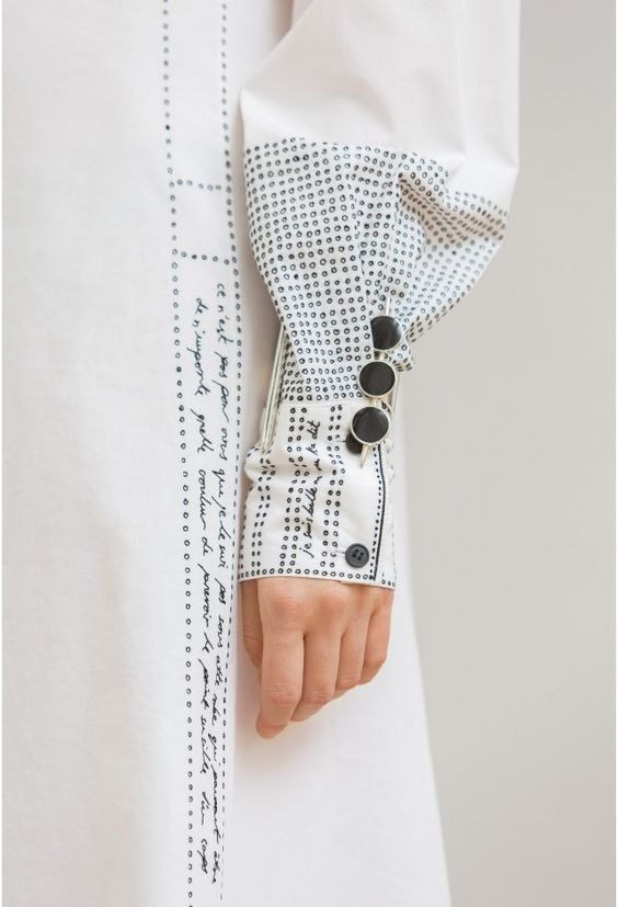 knitgrandeur :     Embroidered sleeve detail with words & dots; sewing; textiles; creative fashion design detail // Lemaire