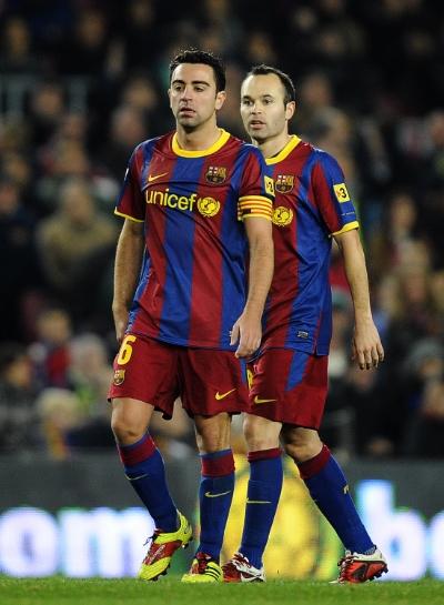 Nøglespillerne Xavi og Iniesta, der har spillet et utal af kampe sammen på klub- og landshold. Foto: David Ramos - Getty Images.