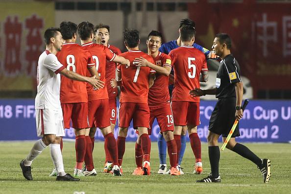 Kinas landshold vinder skam kampe. Her mod Qatar i VM-kval i 2016. Foto: Getty Images/