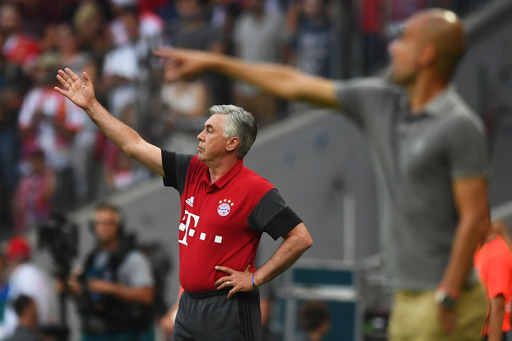 I juli spillede Bayern München en venskabskamp mod Manchester City på Allilanz og her kunne de to træner-legender ses på samme sidelinje. Foto: Getty Images/Lennart Preiss.