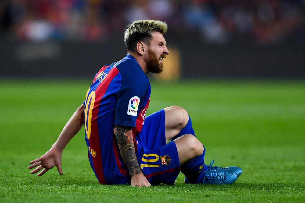 Lionel Messi meldes ude i tre uger efter den lyskeskade, han pådrog sig mod Atletico Madrid.   Foto: Getty Images