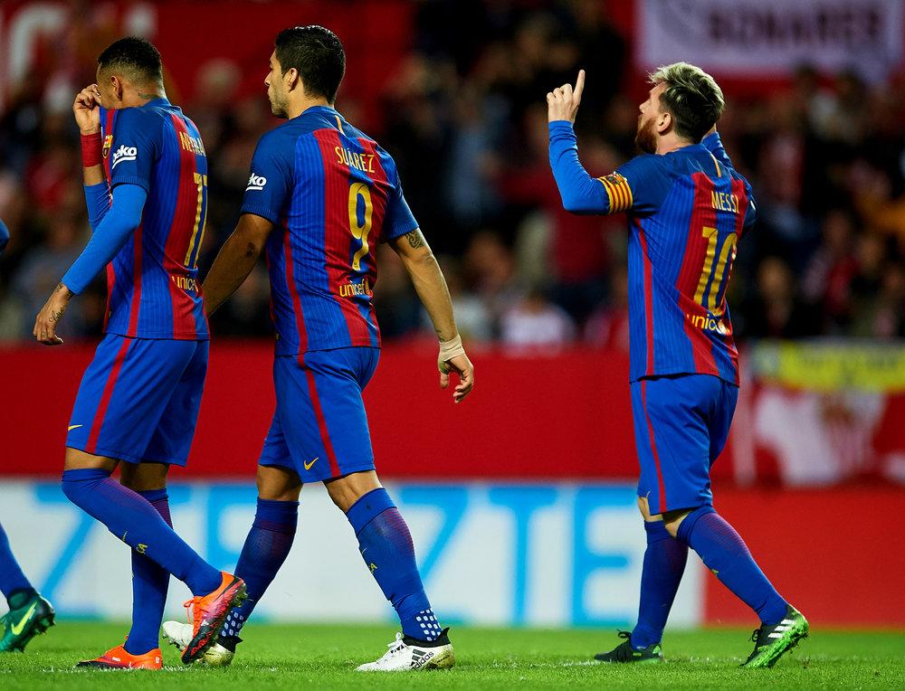 Lionel Messi fejrer sin scoring mod yndlingsmodstanderen Sevilla. Foto: Getty Images