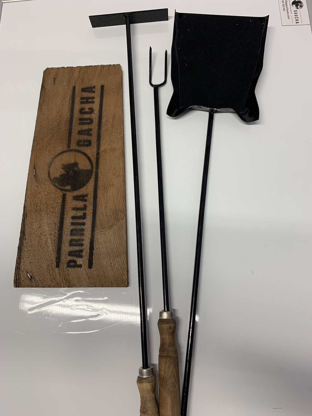 3 Piece Long Handled Asado set £39.95 - The most essential tools for any BBQ chef is the shovel, Poker and cooking fork. Hand made in Argentina these extra long handled fire cooking tools mean that you can control and move the hot embers and turn your meat without getting burnt Knuckels!!!!!Hand crafted from mild steal with wooden handles.78 cm Long