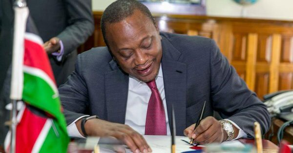Kenyan President Uhuru Kenyatta signs the act. Credit: Business Daily