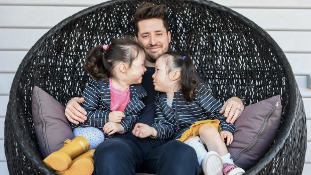 Peter Davis and his twin girls Madeline and Charlotte, participants of the Pretty Powerful campaign in August Credit: Justin McManus
