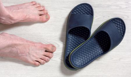 89490645_S_flip_flop_man_feet_floor.jpg