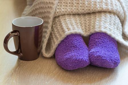 33620020_S_feet_blanket_cold_socks_mug_raynauds_disease_circulation.jpg