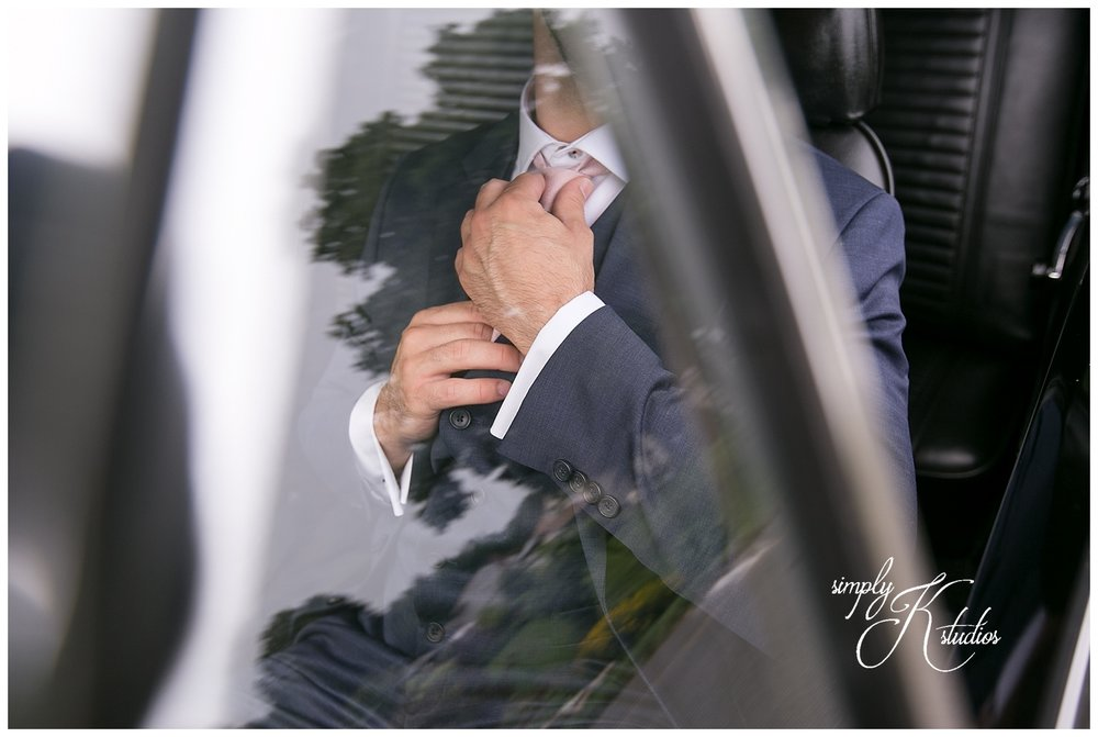 Groom in a Vintage Car.jpg