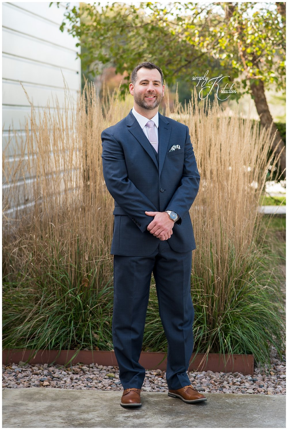 45 Groom wearing a suit.jpg
