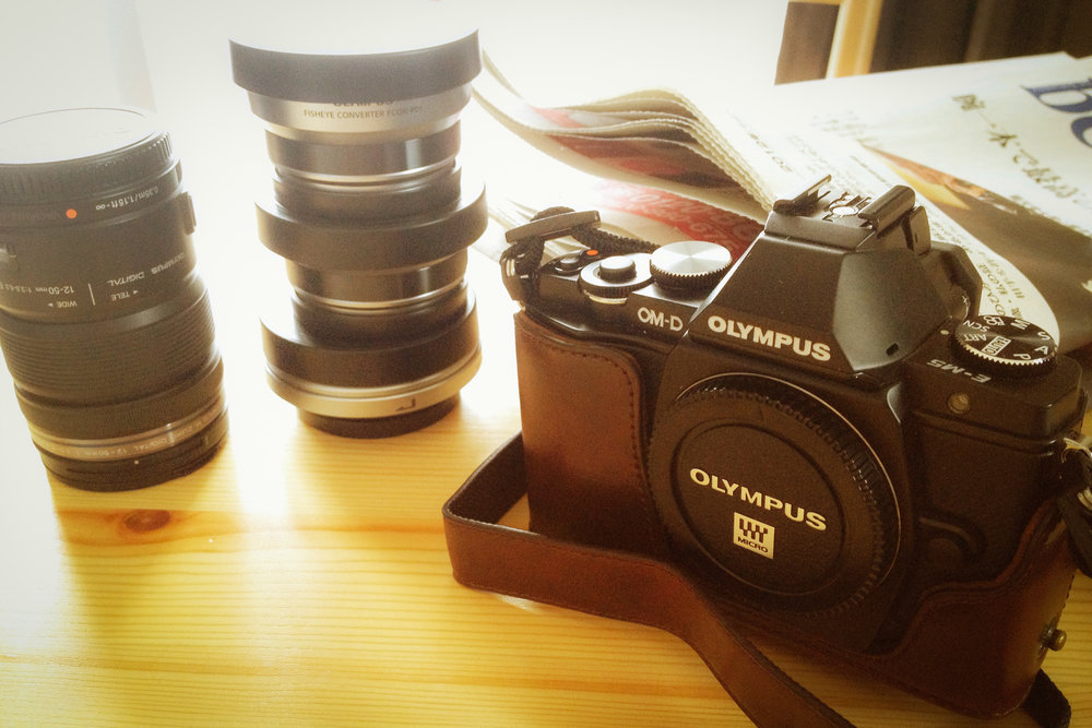 The Olympus OM-D E-M5 with some lenses