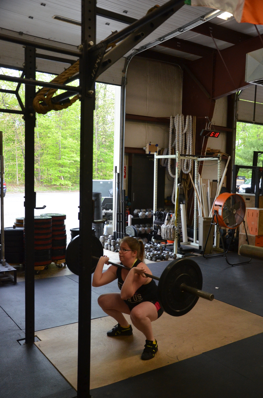 Missy showing great depth at the bottom of her squat.