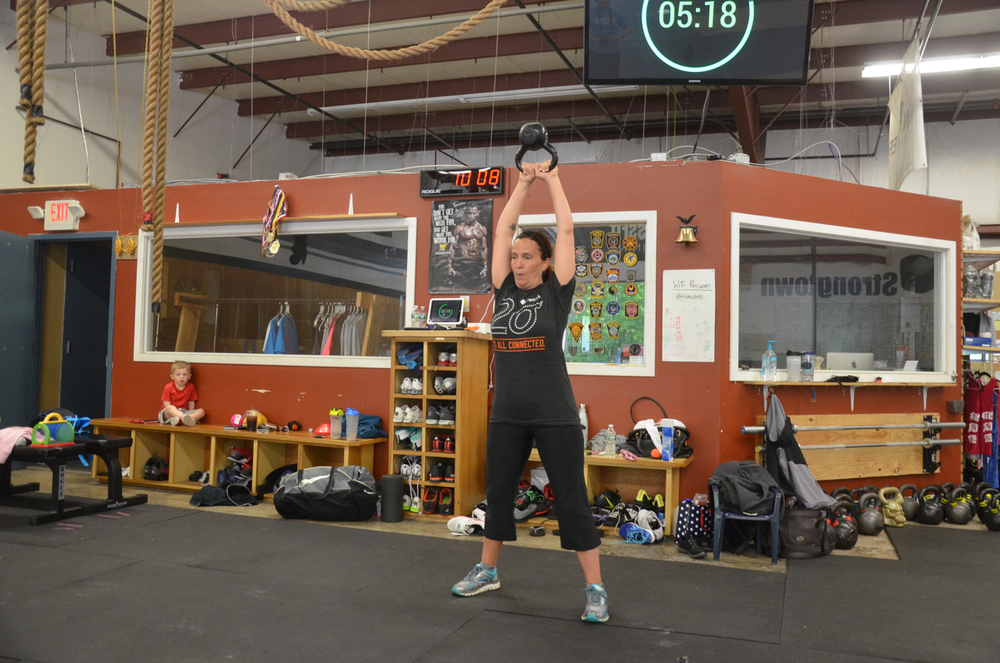 Cari looking strong on her kettlebell swings.