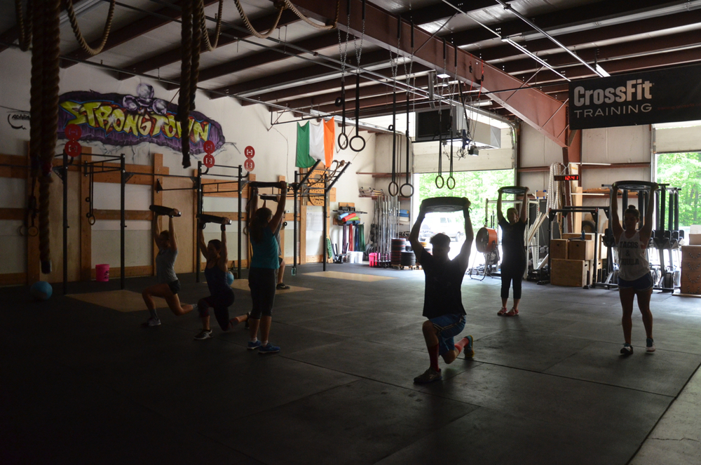 The noon class starting their 2 minutes of overhead walking lunges.
