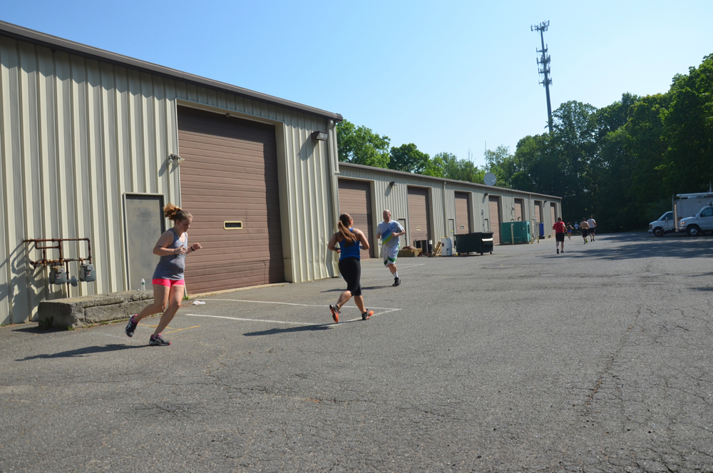 Heidi, Rachel and Saturday's 9AM working through their 800m run.