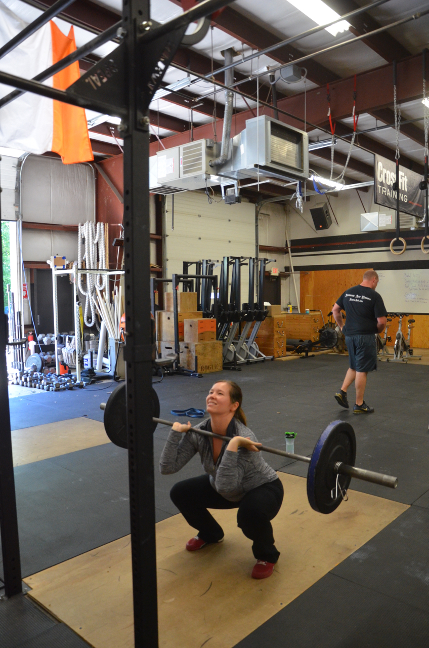 Megan fighting her elbows up through her front squats.