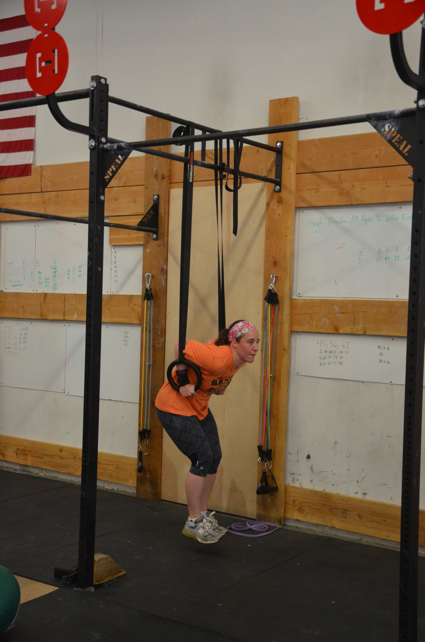 Laura getting her shoulders to the rings during her dips.