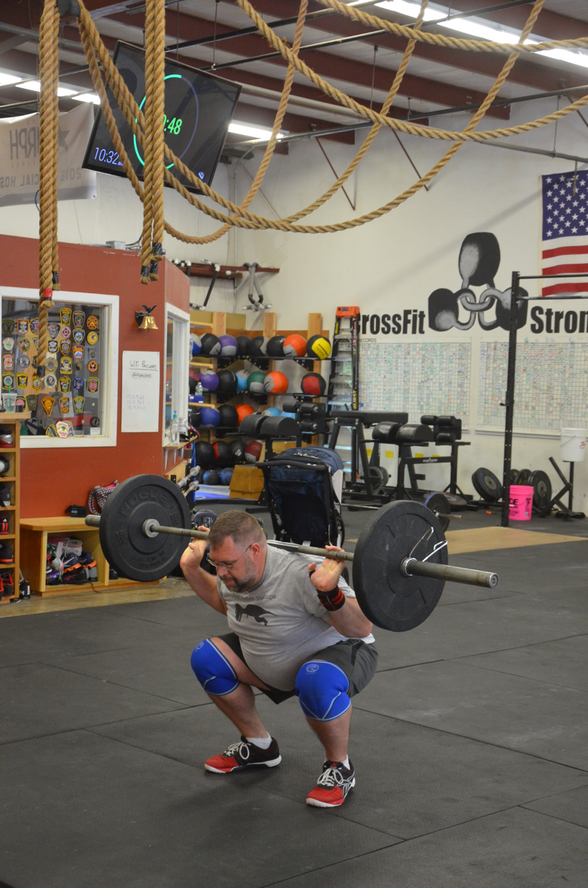 Joe keeping good form through his back squats.