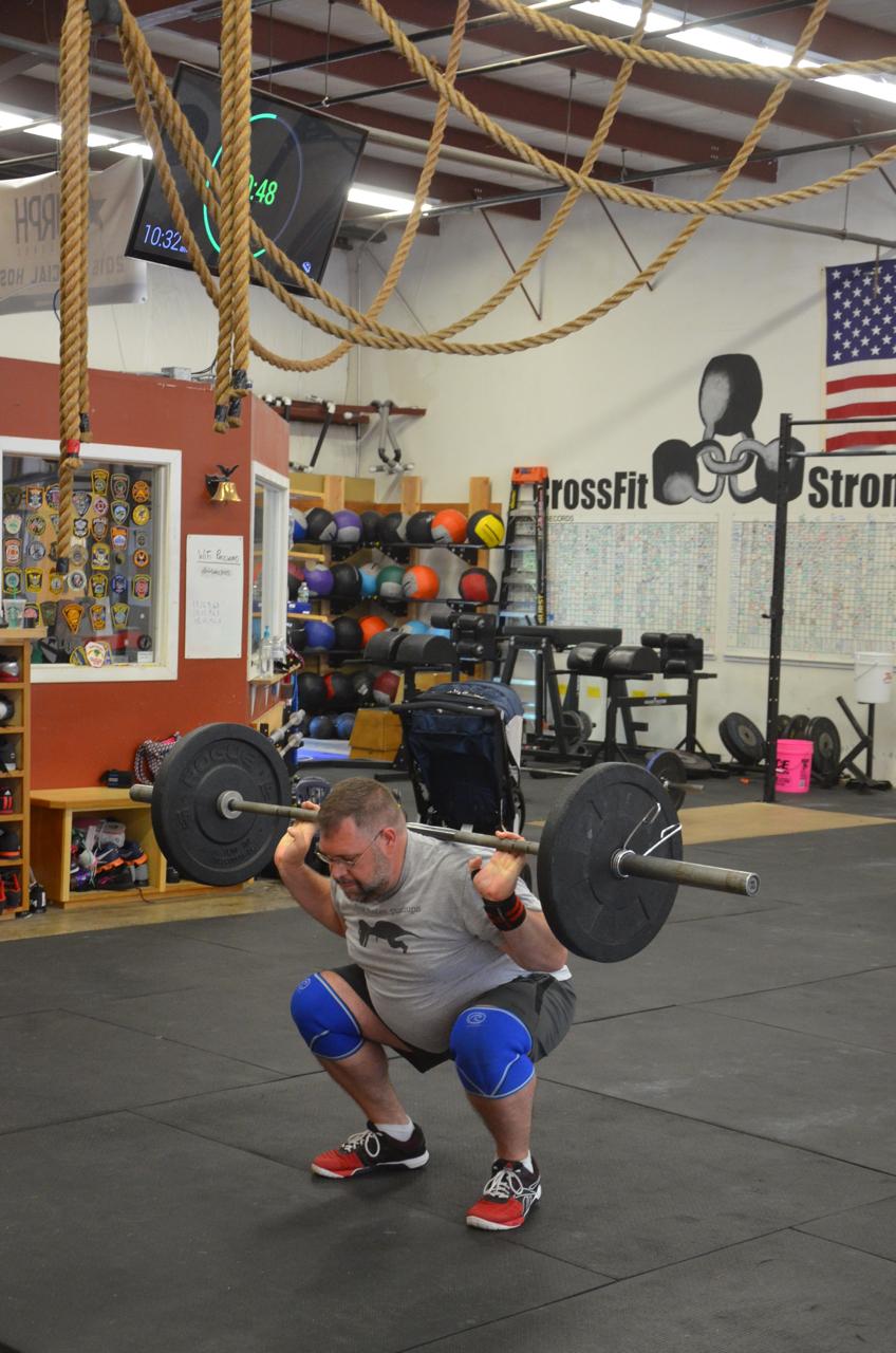 Joe keeping good form through his back squats.