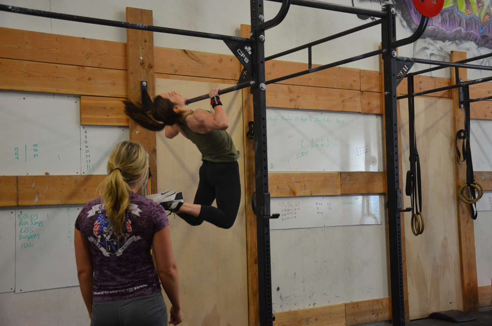 Holly & Cortney looking strong on their 100 pull-ups.