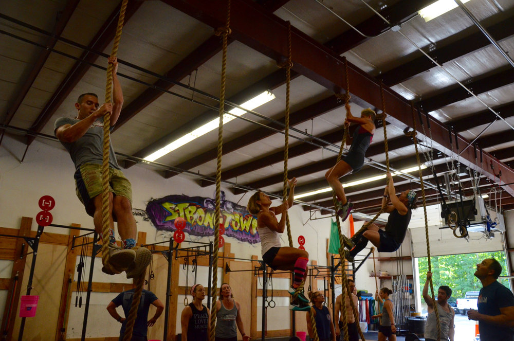 Sunday's class taking on the their rope climbs.