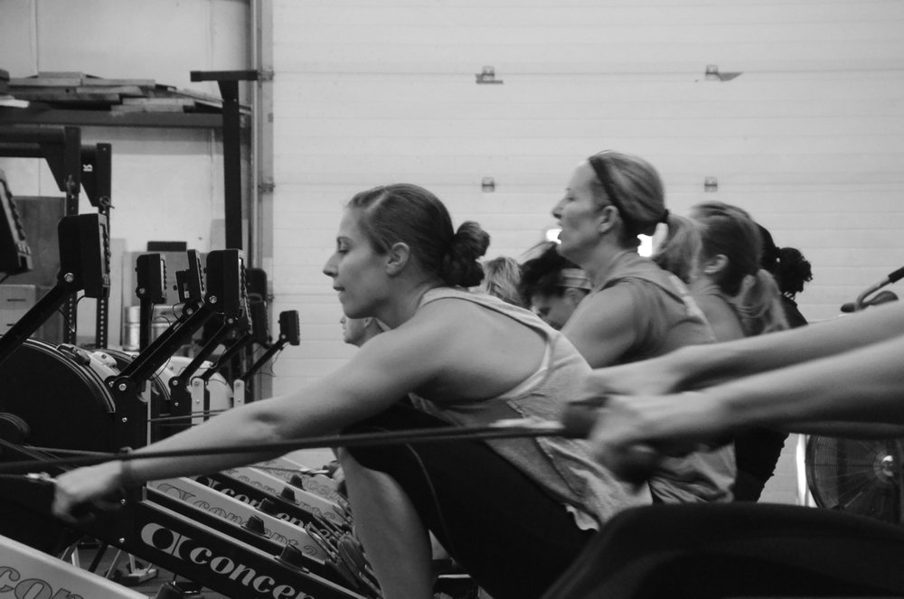 Gail and the 9:30 working through their 500m row.