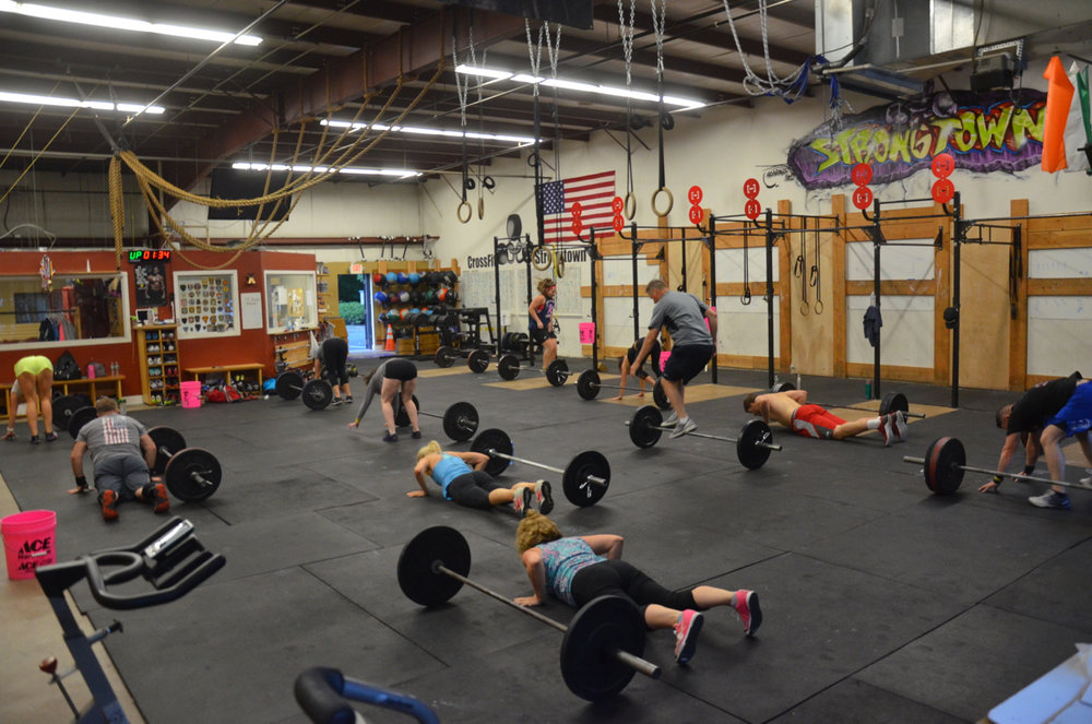The 6pm class working through their lateral bar burpees.