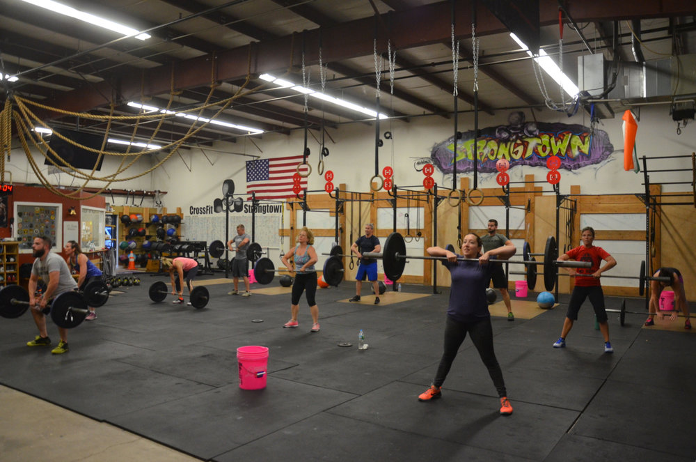 The 6pm class working through their sumo deadlift high-pulls.