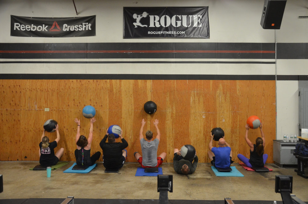The 6pm class working through their wall ball sit-ups.