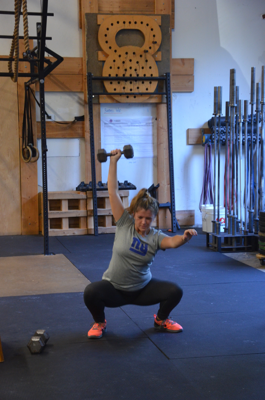 The Maeve killing her single arm overhead squats.