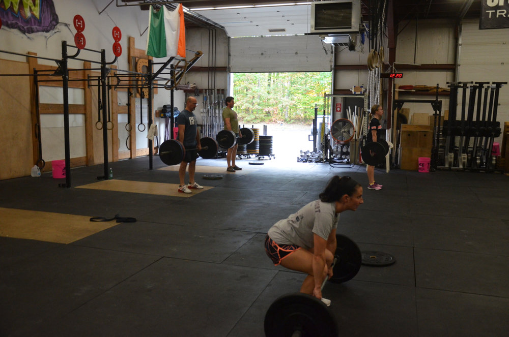 Natalie and the noon warming up their deadlifts.