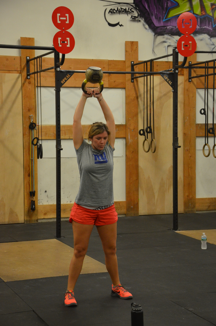 The Maeve swinging the original golden kettlebell.