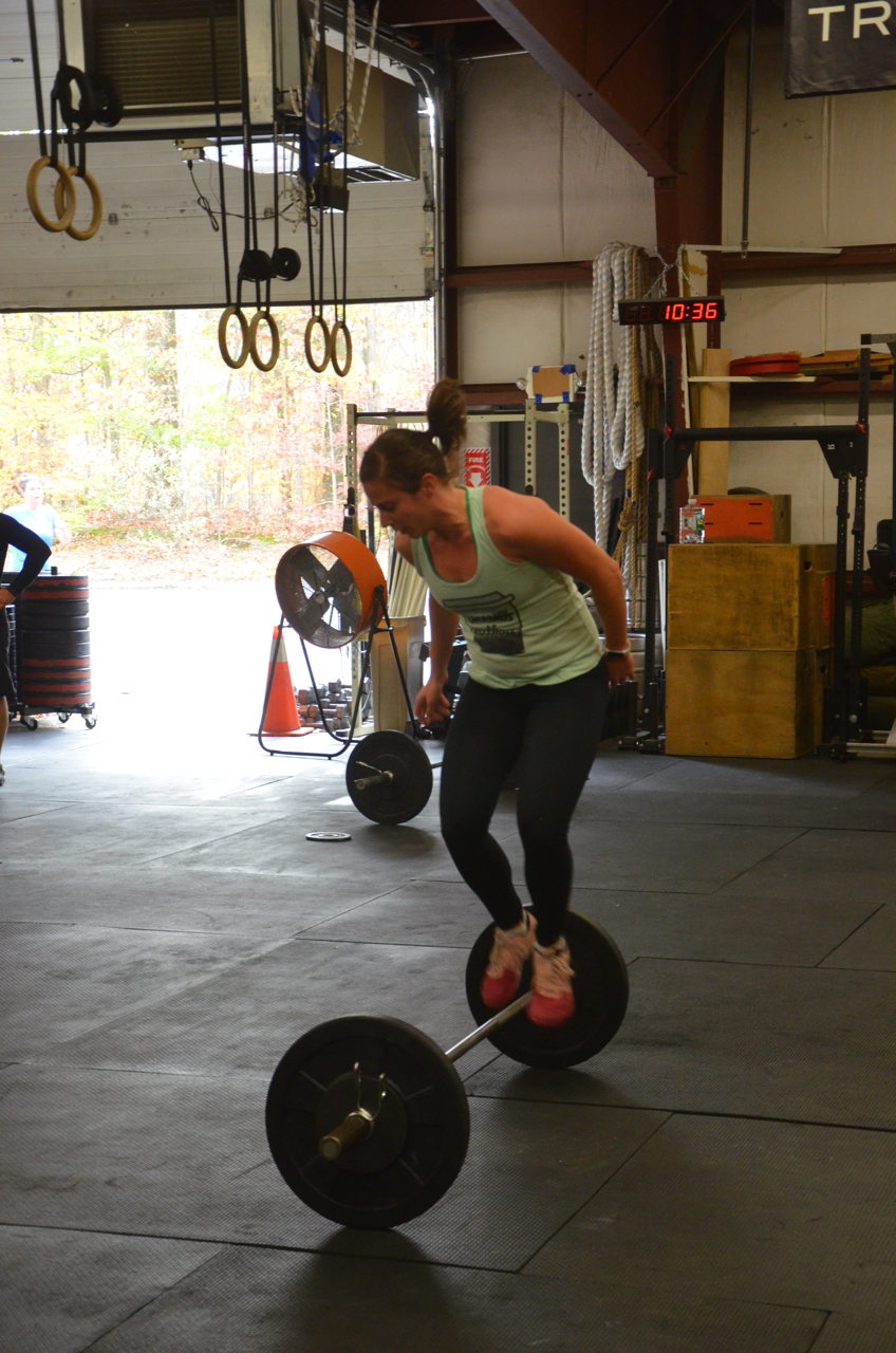 Gail flying through her lateral bar burpees.