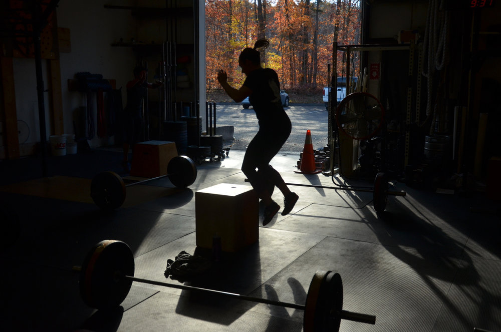 Kelly finishing up her final burpee box jumps.