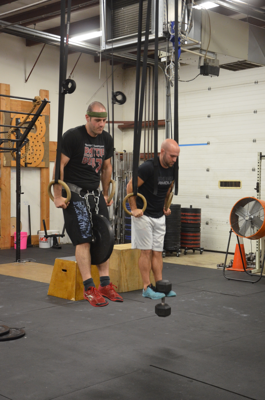 Jimmy & Timmy showing two different ways to add #25 lbs to their ring dips.